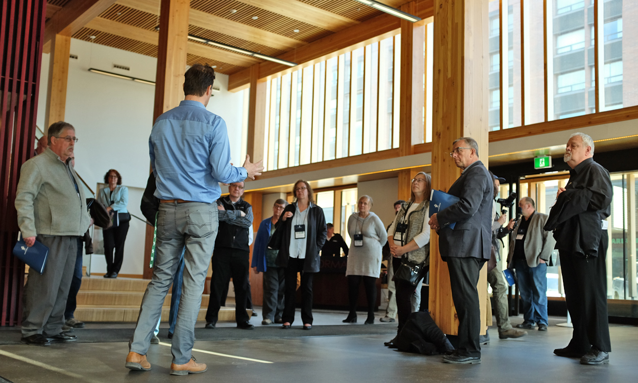 UNBC's Guido Wimmers leads a tour of the Wood Innovation and Design Centre as a model for multi-story wood construction.